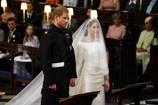 Royal wedding. Prince Harry and Meghan Markle in St George's Chapel at Windsor Castle for their wedding. Picture date: Saturday May 19, 2018. See PA story ROYAL Wedding. Photo credit should read: Dominic Lipinski/PA Wire URN:36583621
