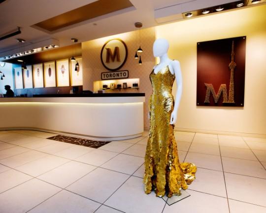 MAGNUM - Fashion designer Zac Posen's 24-karat gold dress